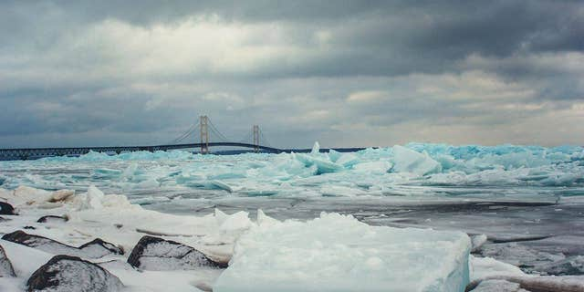 Tori Burley, of Mackinaw City, Michigan, spotted blue ice chunks along the Straits of Mackinac on Sunday.