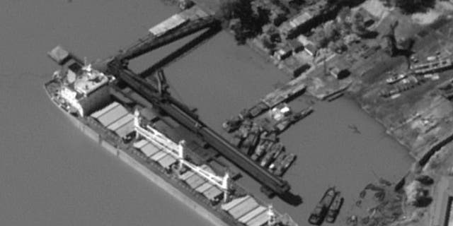The Chinese-owned ship Kai Xiang was photographed appearing to load North Korean coal.