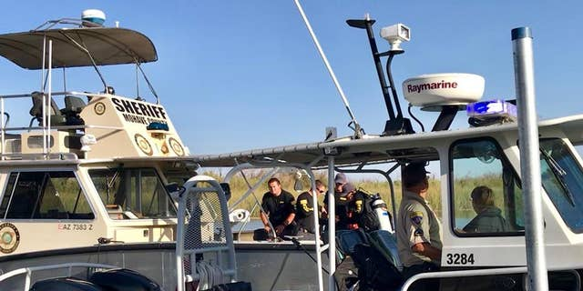 Four people were missing Sunday after a boat collision on the Colorado River ejected passengers and left nine others injured, officials said.