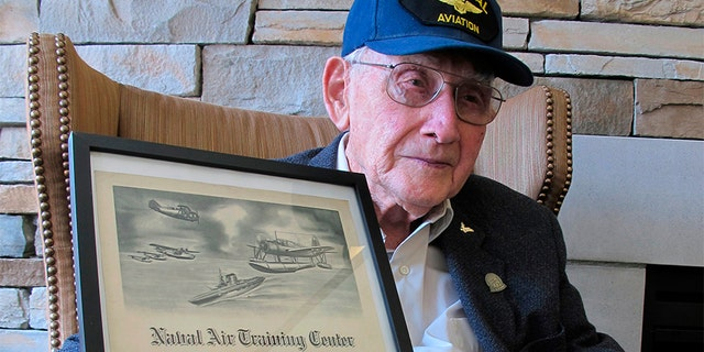 April 25, 2018: World War II veteran Bob Barger poses with his Naval flight school certificate in Toledo, Ohio.