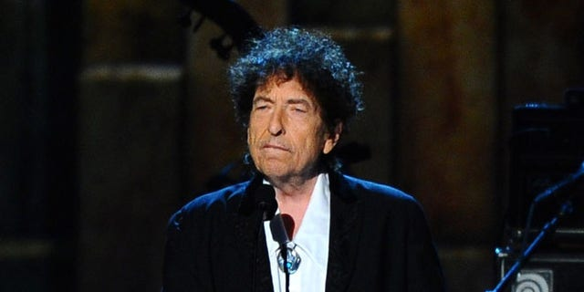 Bob Dylan is shown at an awards event in Los Angeles, Feb. 6, 2015. A door from a room in which he stayed at New York City's Chelsea Hotel recently sold for $125,000.