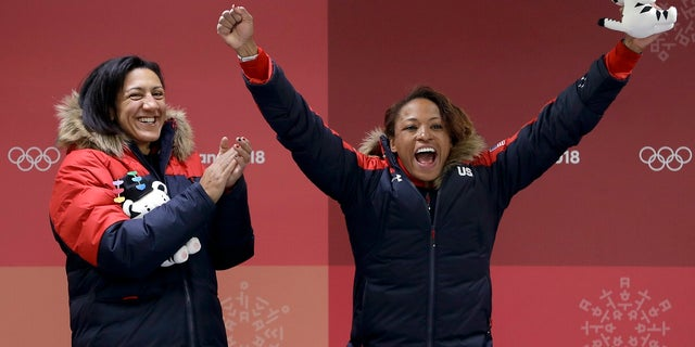 Driver Elana Meyers Taylor, left, and Lauren Gibbs, right, of the United States won silver in women's bobsled.