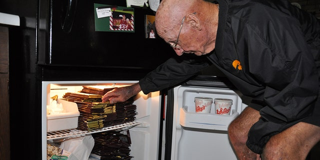 Williams, seen here, stockpiles his fridge with his weekly chocolate haul.
