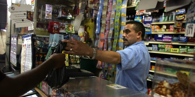 NEW YORK - JUNE 18:  Jesus Martinez works at his bodega grocery store around the corner from where Bolivar Cruz was killed while working at his bodega last week June 18, 2007 in the Queens borough of New York City. Sixteen area bodega stores in Queens have been robbed since March. While crime has dropped throughout New York City, operating a bodega is still a risky job as many clients are poor and the stores are often situated in high crime areas.  (Photo by Spencer Platt/Getty Images)