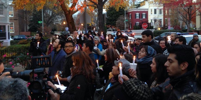 Immigrants hold a protest vigil for immigration reform outside the home of House Speaker John Boehner.