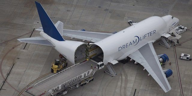 The International Association of Machinists and Aerospace Workers claims that two field organizers had guns pulled on them at the homes of workers of the Boeing South Carolina plant in North Charleston. (Reuters)