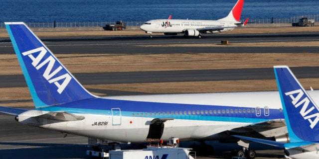 Jan. 30, 2013: All Nippon Airways passenger planes park on the tarmac of Haneda Airport in Tokyo.