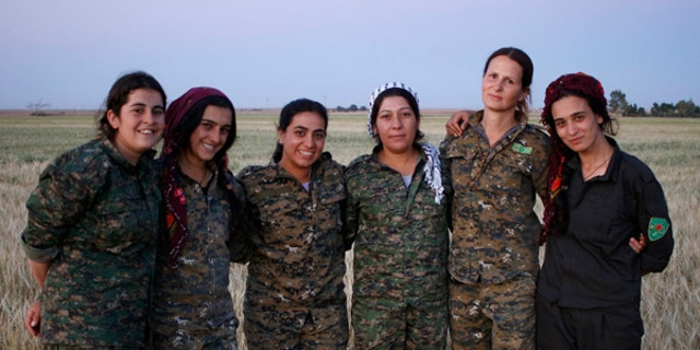 Böhman is pictured with other members of the YPJ – the female brigade of the Kurdish People's Protection Units.