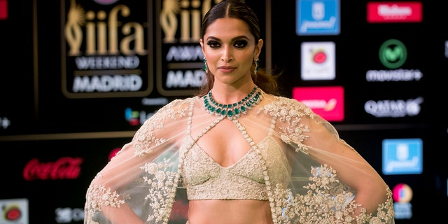 Bollywood actress Deepika Padukone poses for photographers at the International Indian Film Academy Rocks.