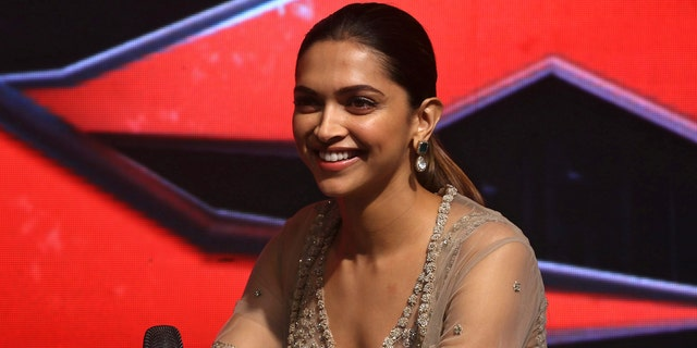 Bollywood actress Deepika Padukone interacts with the media during a news conference in Mumbai.