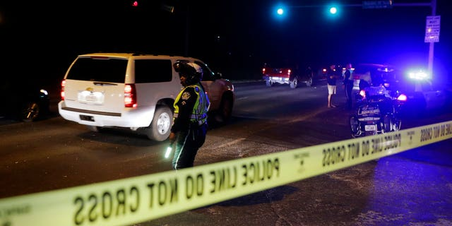 Police continue to restrict access to the neighborhood at the site of Sunday's explosion, early Monday, March 19, 2018, in Austin, Texas. Multiple people were injured in the explosion Sunday night, and police warned nearby residents to remain indoors overnight as investigators looked for possible links to other package bombings elsewhere in the city this month. (AP Photo/Eric Gay)