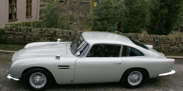 The Aston Martin DB5 driven by James Bond in GoldenEye is set to sell for  £1.6 MILLION at auction.See story SWBOND.In the 1995 film, 007 - played by Pierce Brosnan - raced the classic British sports car around the Monaco hills in pursuit of Xenia Onatopp, the Ferrari-driving assassin played by Famke Janssen.It was Brosnan's first appearance as the MI6 agent - and was the first time Bond drove an Aston Martin DB5 since the days of Sean Connery's playing the spy. After filming,  the 1965 car was used by Eon Productions for promoting the Motion Picture GoldenEye and the retro styled DB7. The DB5 was bought by its current owner in 2001 - and they are now selling it at Bonhams' Festival of Speed sale in Goodwood on July 13. Bonhams has given it a guide price of £1.6 million.