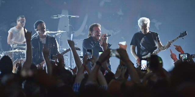 U2 performs during special Apollo Theater performance in New York City.