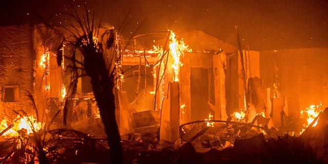 Dec. 8, 2017: Flames consume a structure as the Lilac fire burns in Bonsall, Calif.
