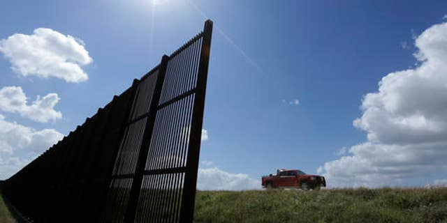 """FILE - In this Sept. 6, 2012, file photo, cotton farmer Teofilo """"Junior"""" Flores drives his truck along the U.S.-Mexico border fence that passes through his property in Brownsville, Texas. President Donald Trump's vow to accelerate construction of a """"contiguous, physical wall"""" along the Mexican border is slamming into a Washington reality _ who's going to pay for it and how? (AP Photo/Eric Gay, File)"""