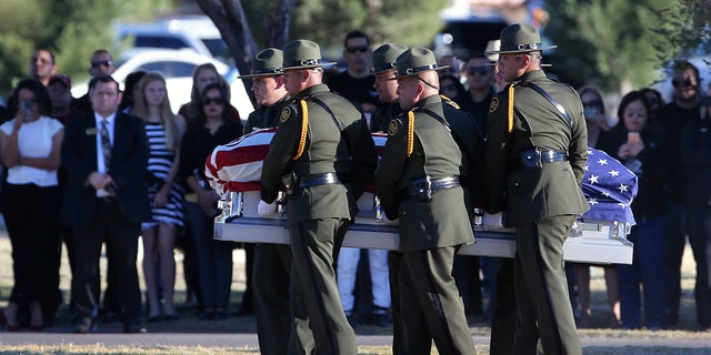 Border Patrol pallbearers carry Border Patrol agent Rogelio Martinez to a graveside service at Restlawn Cemetery, Saturday, Nov. 25, 2017 in El Paso, Texas. Martinez was on patrol in the Big Bend Sector when he died in the line of duty.