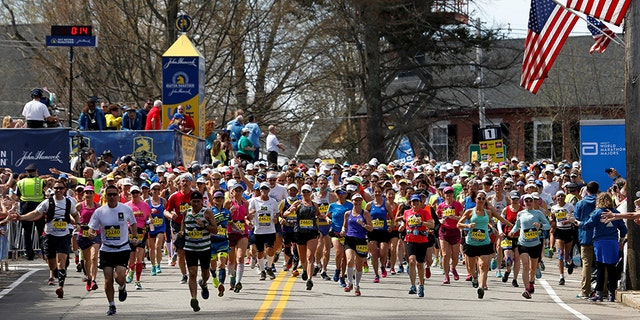 April 17, 2017: Runners cross the starting line at the 121st running of the Boston Marathon.