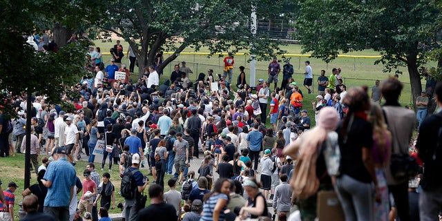 "People assemble on Boston Common before a planned ""Free Speech"" rally by conservative organizers begins, Saturday in Boston."
