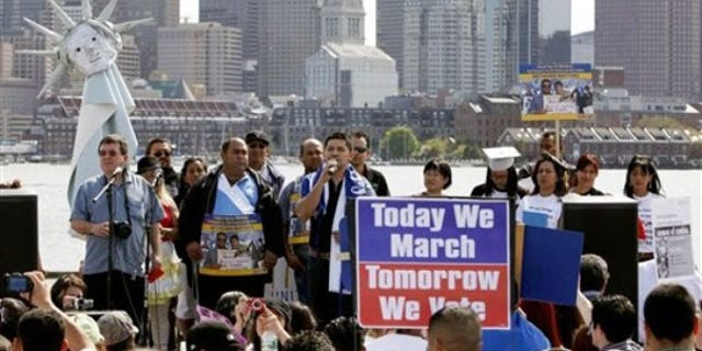 Protesters gather across the harbor from downtown Boston to demand immigration reform and denounce the controversial Arizona immigration law May 1. (AP Photo)
