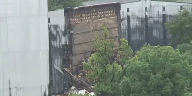 Damage can be seen after a collapsed distillery warehouse poisoned creeks for nearby fish.