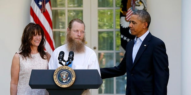 Former President Barack Obama, right, watches as Bob Bergdahl and Jami Bergdahl discuss the release of their son, Bowe Bergdaghl.