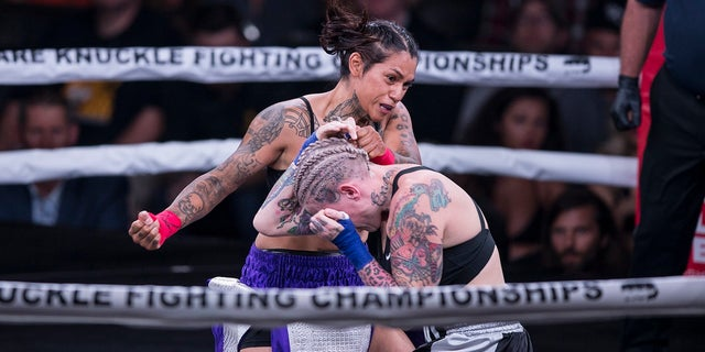 Alma Garcia, left, is seen fighting Bec Rawlings in the only women's fight. Rawlings ultimately won their bout with a TKO.