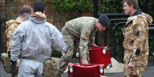 Military personnel outside Bourne Hill police station in Salisbury, England, as police and members of the armed forces probe the suspected nerve agent attack on a former Russian spy.