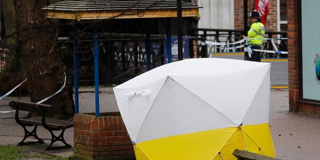 """A police tent covers the the spot where former Russian double agent Sergei Skripal and his daughter Yulia were found critically ill following exposure to a """"nerve agent substance"""" in Salisbury, England, Monday, March 12, 2018. (AP Photo/Frank Augstein)"""