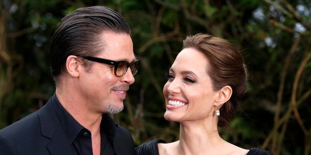 May 8, 2014. Brad Pitt and Angelina Jolie arrive for a special Maleficent Costume Display at Kensington Palace in London.