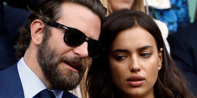 Actor Bradley Cooper, left, speaks with his then-girlfriend, supermodel Irina Shayk on the fourteenth day of the Wimbledon Tennis Championships in London, Sunday, July 10, 2016.
