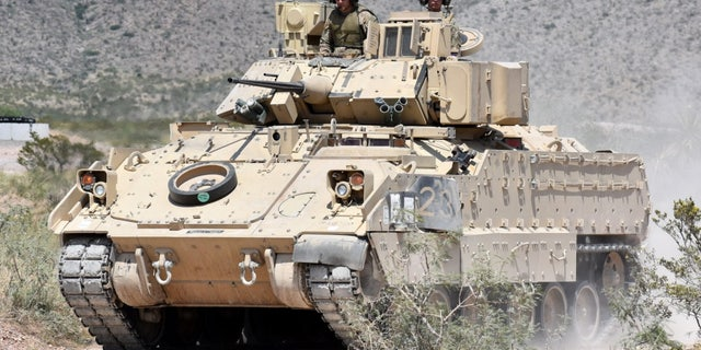 An M2A3 Bradley Fighting Vehicle crew heads to the range during gunnery training at the Doña Ana Range Complex, N.M., Aug. 3, 2018. (Winifred Brown, Fort Bliss Public Affairs Office)