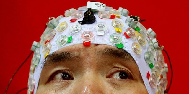 File photo: Hong Gi Kim of South Korea competes during the Brain-Computer Interface Race (BCI) at the Cybathlon Championships in Kloten, Switzerland October 8, 2016. (REUTERS/Arnd Wiegmann)
