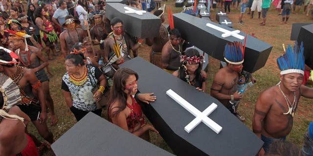 To commemorate the indigenous people killed in recent years, protesters left dozens of coffins in front of the parliament building.