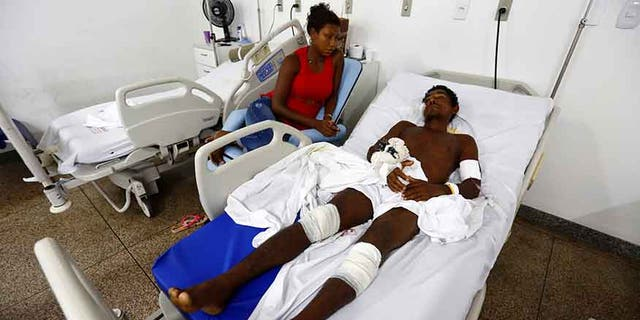 Jose Ribamar from Brazil's indigenous Gamela tribe is pictured next to his daughter at a hospital after he was injured in a dispute over land in northern Brazil, in Sao Luis, Maranhao state, Brazil, May 2, 2017.