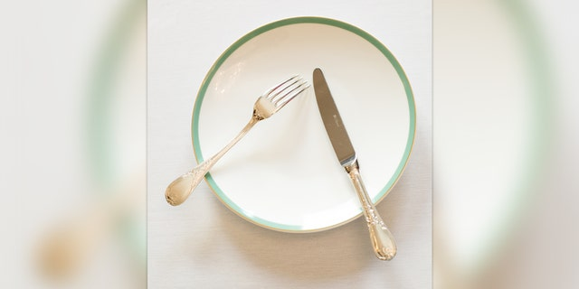 This is the way you leave your cutlery when you are breaking from a meal.