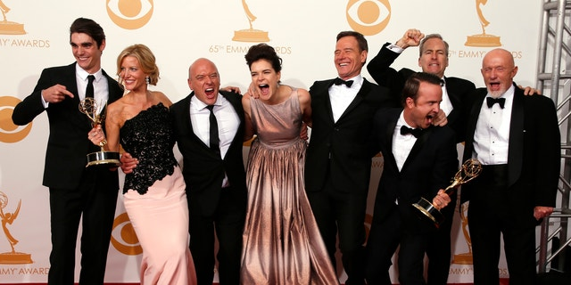 """The cast from AMC's series """"Breaking Bad"""" poses backstage with their awards for Outstanding Drama Series at the 65th Primetime Emmy Awards in Los Angeles September 22, 2013."""
