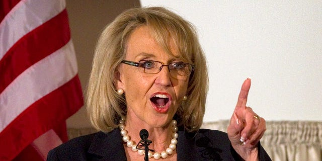 Arizona Gov. Jan Brewer, R, speaks Tuesday, April 19, 2011 at the Governor's Volunteer Awards luncheon in Phoenix.  (AP)