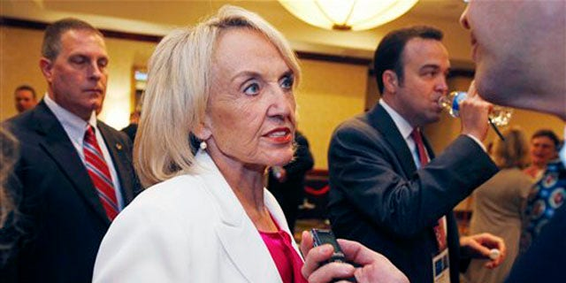 Arizona Gov. Jan Brewer speaks with a reporter during the annual meeting of the National Governors Association July 11. (AP Photo)