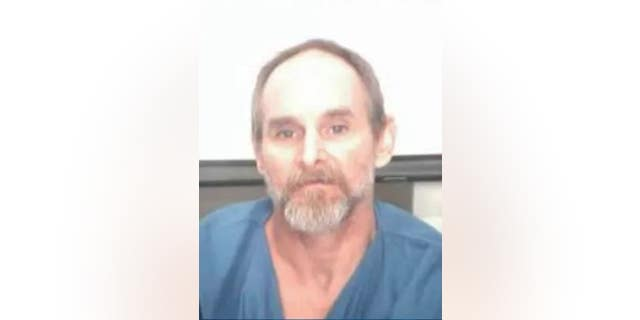 Authorities are searching for Brian Smith, who has been charged with murder, after he was mistakenly released from jail on Tuesday.