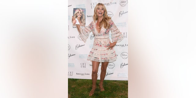 Brinkley shows off her Social Life Magazine cover while at her Hamptons soiree on Saturday, July 21.