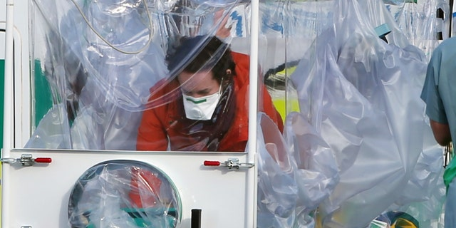 Ebola nurse Pauline Cafferkey being transported to a military aircraft in Scotland before being flown to London.