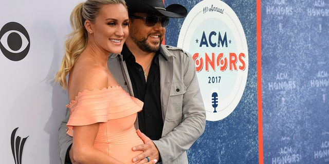 Jason Aldean and his wife Brittany Kerr arive at the 11th Annual ACM Honors in Nashville, Tennessee.