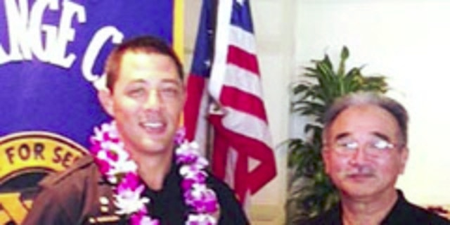"""Kaliloa, a 10-year police veteran, was honored as the """"Officer of the Month"""" in April 2014."""