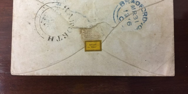 The reverse of the envelope addressed to Bronte's friend Ellen Nussey postmarked 1846 (Henry Aldridge & Son).