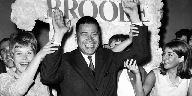 Sept. 14, 1966: This file photo shows Edward W. Brooke joining campaign workers in celebration, in Boston, after winning the Republican nomination for U.S. Senate. (AP)