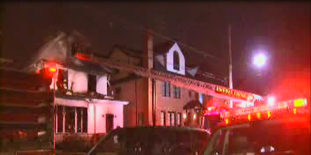 """Fire broke out at the Brooklyn home about 2:15 a.m., leaving most of the building """"heavily damaged,"""" officials said."""