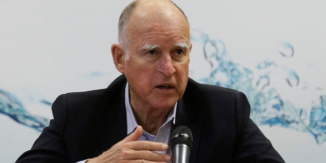 Apr. 16, 2015: Gov. Jerry Brown responds to a reporters question after a meeting with businesses affected by the drought at his Capitol office in Sacramento, Calif. (AP)