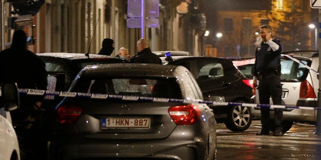 March 25, 2016: Police guard a checkpoint and man positions during a police raid in the suburb of Schaerbeek in Brussels.