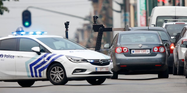 A bomb disposal squad is deployed after Belgian police shot at a vehicle in the Brussels district of Molenbeek after the driver of the vehicle claimed to have explosives on board, Belgian broadcaster VRT reported on Tuesday.