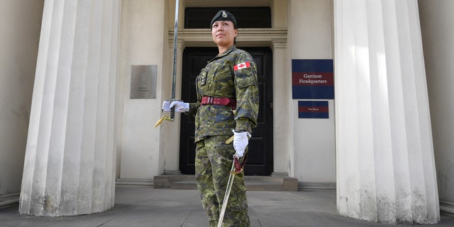 Captain Megan Couto of the 2nd Battalion, Princess Patricia's Canadian Light Infantry, poses for a photograph at Wellington Barracks, in central London, Britain June 26, 2017.